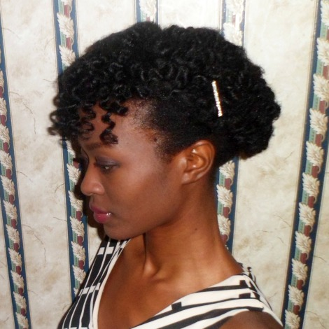 I achieved this Bantu Knot Updo by making small bantu knots in my hair and just pinning the hair up