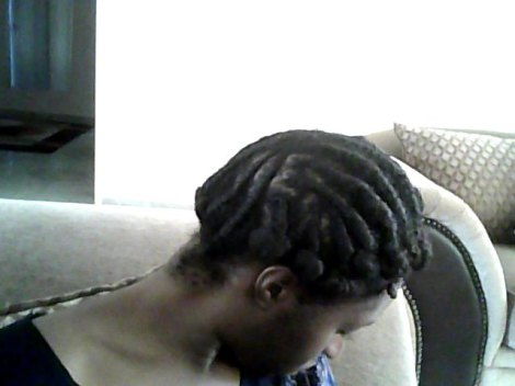 I flat twisted damp hair setting, it with a mixture of shea butter and flax seed gel. I bantu knotted the ends for extra curl.