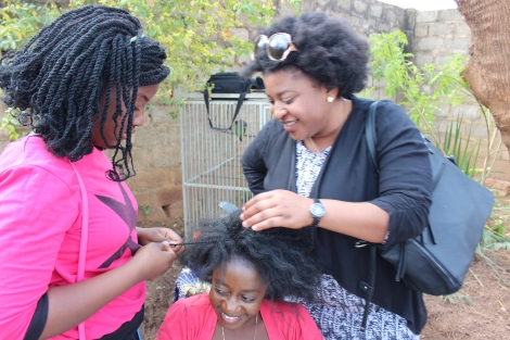 This lady was pleasantly surprised to find that her daughter was a natural at flat twisting after a few minutes practice on Chiteu's hair.