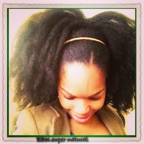 Afro-puff Ponytail - This Afro puff ponytail was achieved on stretched hair by securing my hair in a ponytail using a big hair band- I used gel to sleek down my edges and used a hair band to accessorise and flatten my thick hair.