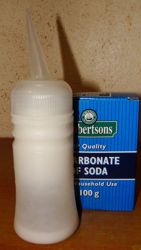 I use an applicator bottle to apply the baking soda/bicarbonate of soda rinse to my hair.