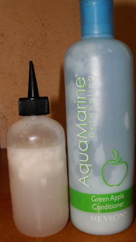Mix silicone-free conditioner with water. Shake bottle. Apply to hair
