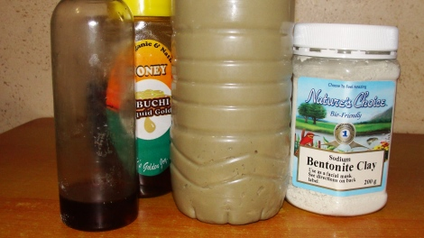 The ingredients used in my clay rinse with the pre-mixed bottle in the centre