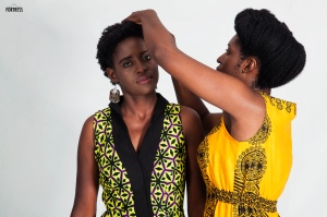 Mwanabibi styling Fashion Yapa Zed's winner Asimbuyu's hair. The image was captured by Fortress New Media.