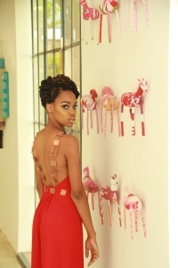 This was an updo created on braided hair. The same hairstyle can be achieved with locs.